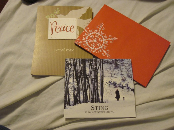 What I've been up to this evening: filling out holiday cards and listening to Christmas music in bed. :)