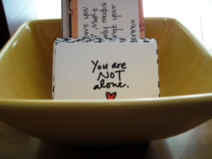 My Mondo Beyondo affirmation cards in their bowl on my altar in my room.
